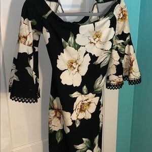 Black dress with white flowers.